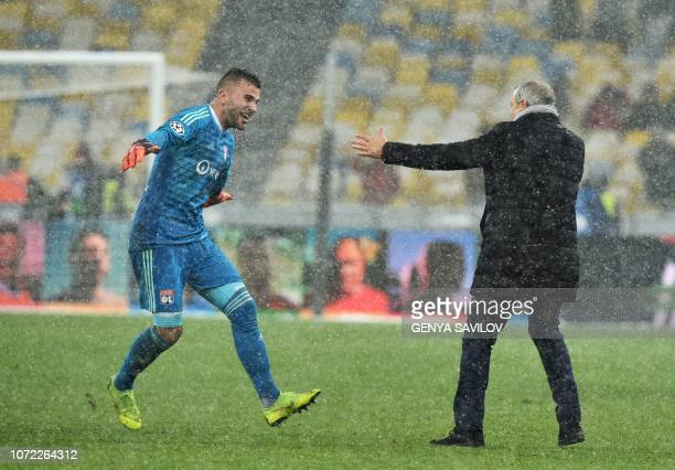 Lyon's Portuguese goalkeeper Anthony Lopes and Lyon's French coach Bruno Genesio react after the UEFA Champions League Groupe F football match FC...