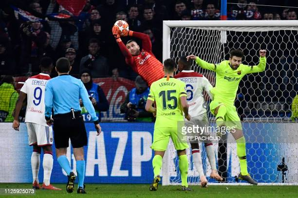 Lyon's Portuguese goalkeeper Anthony Lopes catches the ball next to Barcelona's Spanish defender Gerard Pique and Barcelona's French defender Clement...