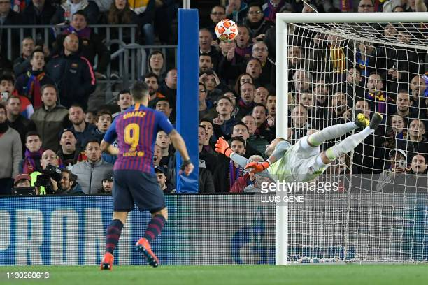 Lyon's Portuguese goalkeeper Anthony Lopes dives for the ball during the UEFA Champions League round of 16 second leg football match between FC...