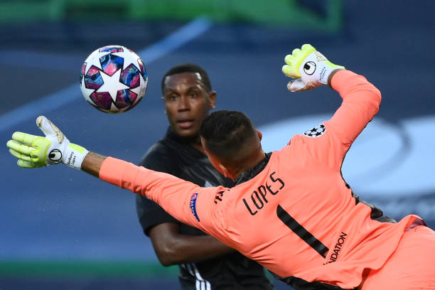 Lyon's Portuguese goalkeeper Anthony Lopes dives for the ball during the UEFA Champions League quarterfinal football match between Manchester City...