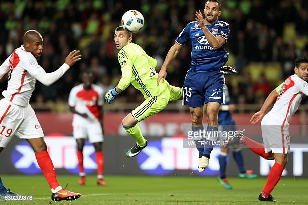 Lyon's Portuguese goalkeeper Anthony Lopes heads the ball away from the goal next to Lyon's French defender Jeremy Morel during the French L1...