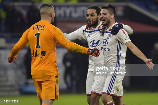 Lyon's Portuguese goalkeeper Anthony Lopes jubilates with Lyon's Belgian defender Jason Denayer and Lyon's French defender Leo Dubois at the end of...