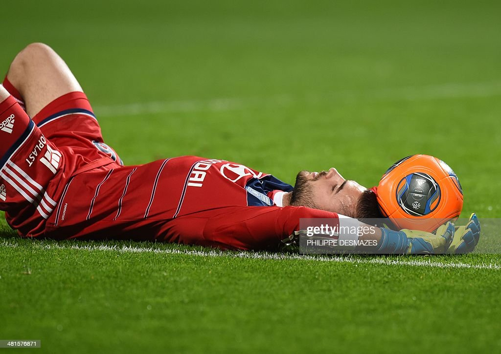 Lyon's Portuguese goalkeeper Anthony Lopes lies on the pitch following the French L1 football match Olympique Lyonnais (OL) vs Saint-Etienne (ASSE) at the Gerland stadium in Lyon, southeastern France, on March 30, 2014. Saint Etienne defeated Lyon 2-1.