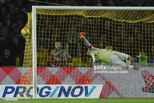 Lyon's Portuguese goalkeeper Anthony Lopes misses to stop a shot by Nantes' Belgian forward Anthony Limbombe during the French L1 football match...