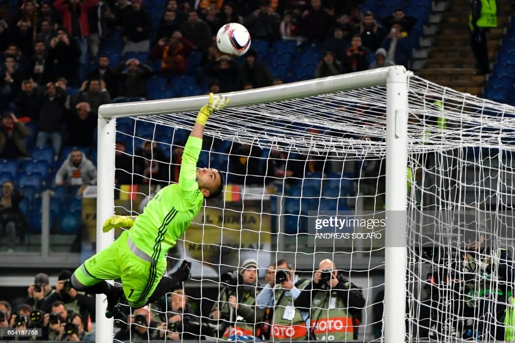 TOPSHOT - Lyon's Portuguese goalkeeper Anthony Lopes saves the ball during the qualifying UEFA Europa League match AS Roma versus Lyon at the Olympic stadium in Rome on March 16, 2017. /