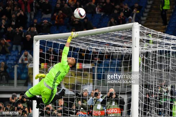 TOPSHOT Lyon's Portuguese goalkeeper Anthony Lopes saves the ball during the qualifying UEFA Europa League match AS Roma versus Lyon at the Olympic...