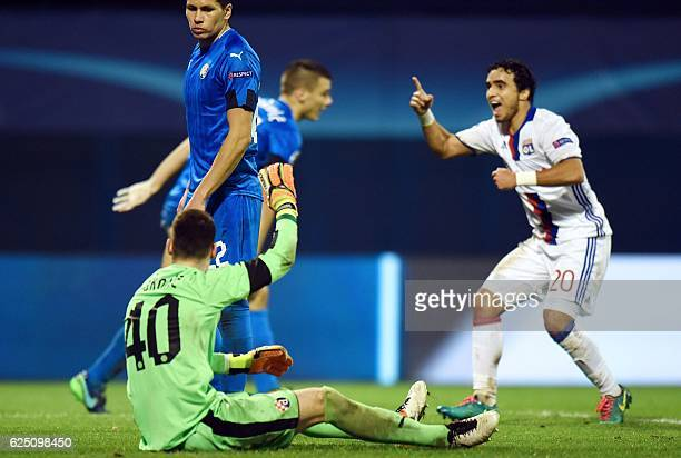 Lyon's Rafael celebrates after his team scored a goal next to Zagreb's Argentine defender Leonardo Sigali during the UEFA Champions League Group H...