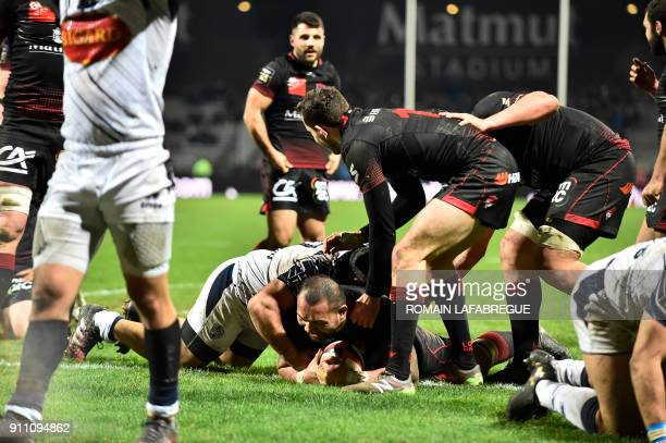 Lyon's Samoan lock Taiasina Tuifu'a scores a try during the French Top 14 rugby union match between Lyon and Agen on January 27 2018 at the Matmut...