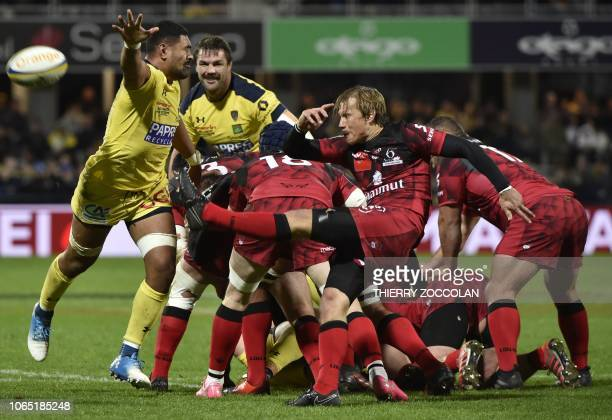 TOPSHOT Lyon's South African scrumhalf Charl McLeod clears the ball from a ruck during the French Top 14 rugby union match between ASM Clermont and...