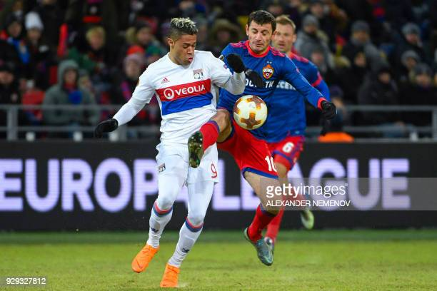 Lyon's Spanish forward Mariano Diaz and CSKA Moscow's midfielder from Russia Alan Dzagoev vie for the ball during the UEFA Europa League round of 16...