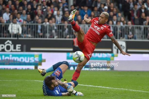 Lyon's Spanish forward Mariano Diaz vies with Angers' French goalkeeper Alexandre Letellier during the French L1 football match between Angers and...