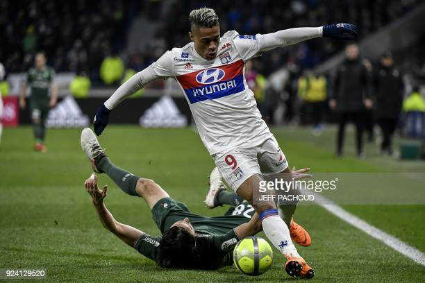 Lyon's Spanish forward Mariano Diaz vies with SaintEtienne's Serbian defender Neven Subotic during the French L1 football match Olympique Lyonnais...