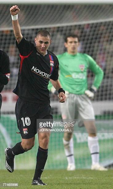 Lyon's striker Karim Benzema celebrates after scoring during the Stuttgart vs Lyon group E Champions League football match in Stuttgart 23 October...