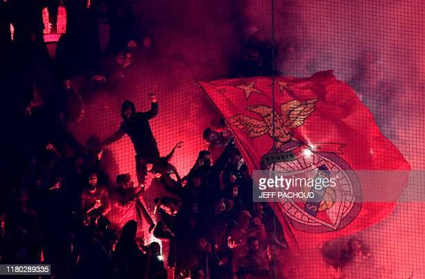 Lyon's supporters light flares during the UEFA Champions League Group G football match between Olympique Lyonnais and SL Benfica at the Decines...