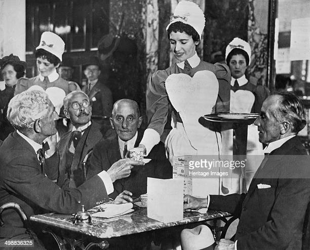 Lyons tea shop Piccadilly London A waitress serves her customers The Lyons waitresses were known as nippies The first Lyons teashop opened in...