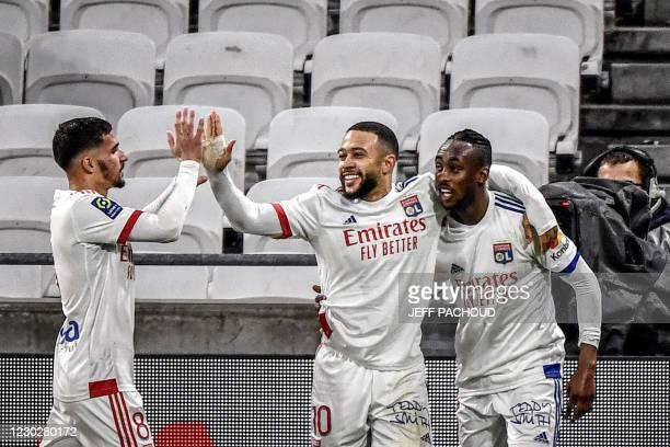 Lyon's Zimbabwean forward Tino Kadewere celebrates with his teammates Lyon's French midfielder Houssem Aouar and Lyon's Dutch forward Memphis Depay...