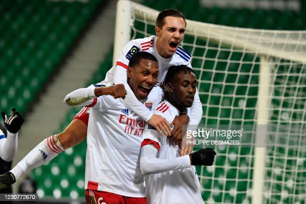 Lyon's Zimbabwean forward Tino Kadewere is congratulated by teammates, including Lyon's Brazilian defender Marcelo after scoring a goal during the...