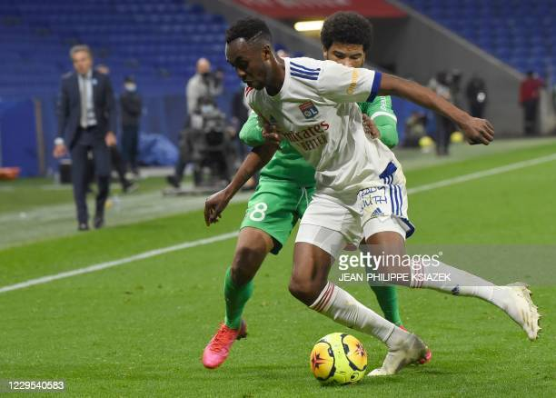 Lyon's Zimbabwean forward Tino Kdewere fights for the ball with SaintEtienne's French midfielder Mahdi Camara during the French L1 football match...