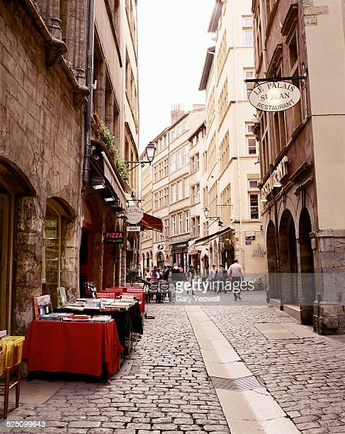 Lyon,Typical narrow cobbled street with tourists