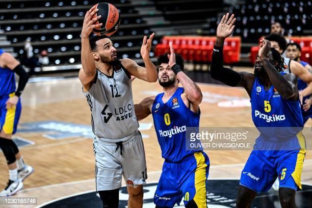 Lyon-Villeurbanne's French player Amine Noua takes a shot during the Euroleague basket-ball match between Asvel Lyon-Villeurbanne and Maccabi...