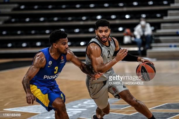 Lyon-Villeurbanne's US player Allerik Freeman fights for the ball with MACCABI TEL AVIVS US player Chris Jones during the Euroleague basket-ball...