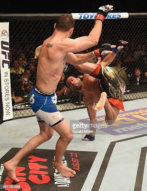 Lyoto Machida kicks UFC middleweight champion Chris Weidman in their UFC middleweight championship fight at UFC 175 inside the Mandalay Bay Events...