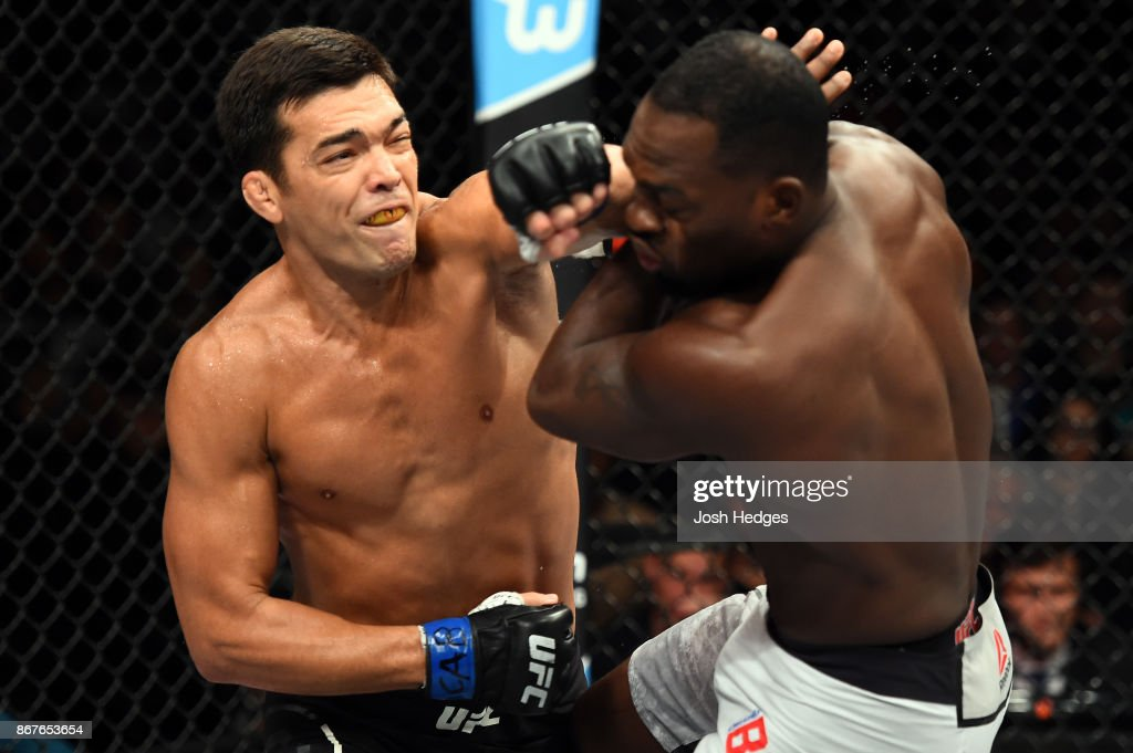Lyoto Machida of Brazil punches Derek Brunson in their middleweight bout during the UFC Fight Night event inside the Ibirapuera Gymnasium on October 28, 2017 in Sao Paulo, Brazil.