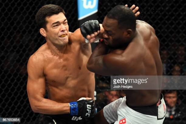 Lyoto Machida of Brazil punches Derek Brunson in their middleweight bout during the UFC Fight Night event inside the Ibirapuera Gymnasium on October...