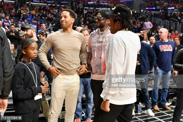 Lyra Carter, Maverick Carter, 2 Chainz, Jay-Z attend a basketball game between the Los Angeles Clippers and the Los Angeles Lakers at Staples Center...