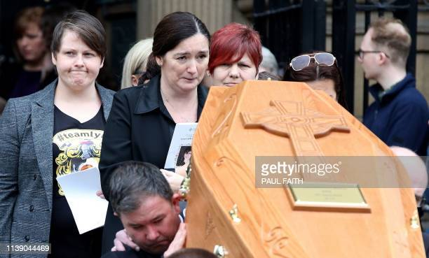 TOPSHOT Lyra McKee's partner Sara Canning reacts as pallbearers carry the coffin of journalist Lyra McKee killed by a dissident republican...