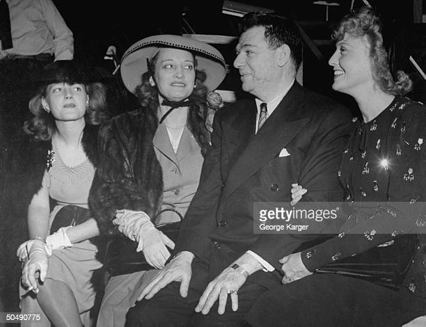 Lyricist Oscar Hammerstein II sitting with singer Jeanette MacDonald and his family