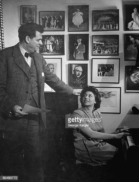 Lyricist Oscar Hammerstein II talking with his wife