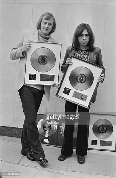 Lyricist Tim Rice and composer Andrew Lloyd Webber, with their awards to commemorate the sale of more than two million dollars worth of the...