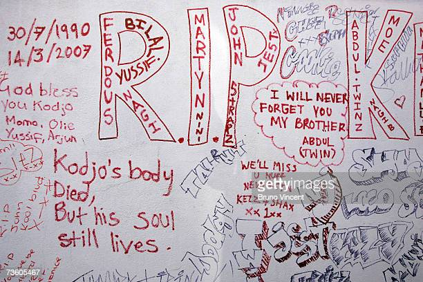 Lyrics and tributes written by friends of the murdered teenager Kodjo Yenga decorate a wall near to where he was stabbed on Wednesday in Hammersmith...
