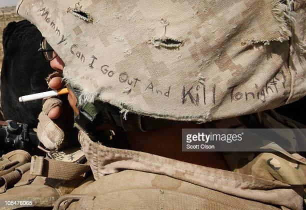 Lyrics from a Misfits song Mommy Can I Go Out And Kill Tonight decorate the helmet of Marine Cpl Jonathan Eckert of Oak Lawn IL attached to India...