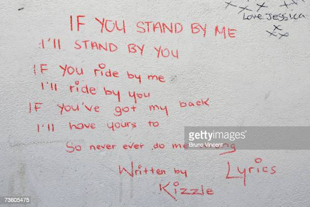 Lyrics written by murdered teenager Kodjo Yenga decorate a wall near to where he was stabbed on Wednesday in Hammersmith Grove March 16 2007 in...