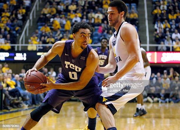 Lyrik Shreiner of the TCU Horned Frogs handles the ball in front of Nathan Adrian of the West Virginia Mountaineers during the game at the WVU...