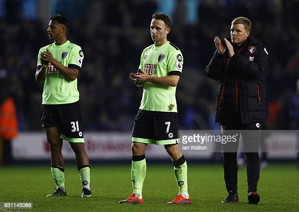 Lys Mousset Marc Pugh and Eddie Howe manager of AFC Bournemouth react during the Emirates FA Cup third round match between Millwall and AFC...