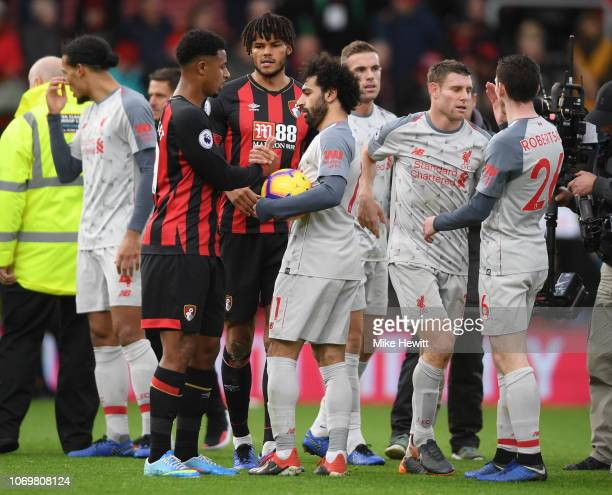Lys Mousset of AFC Bouremouth shakes hands with Mohamed Salah ofLiverpool after the Premier League match between AFC Bournemouth and Liverpool FC at...