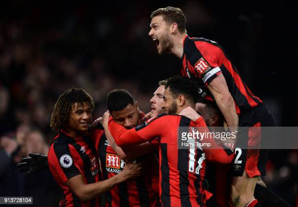 Lys Mousset of AFC Bournemouth celebrates scoring his side's second goal with team mates during the Premier League match between AFC Bournemouth and...
