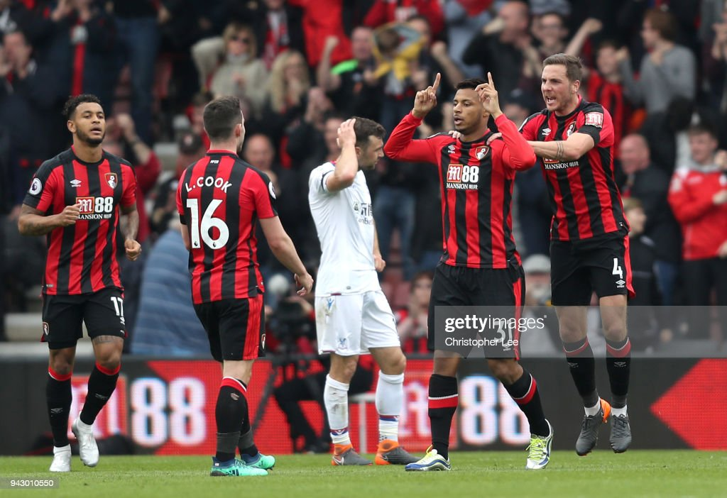Lys Mousset of AFC Bournemouth celebrates with teammate Dan Gosling after scoring his sides first goal during the Premier League match between AFC Bournemouth and Crystal Palace at Vitality Stadium on April 7, 2018 in Bournemouth, England.