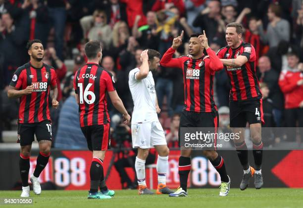 Lys Mousset of AFC Bournemouth celebrates with teammate Dan Gosling after scoring his sides first goal during the Premier League match between AFC...