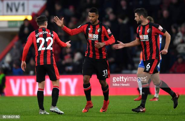 Lys Mousset of AFC Bournemouth celebrates with teammates after scoring his sides first goal during the The Emirates FA Cup Third Round match between...