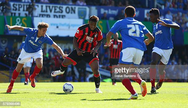 Lys Mousset of AFC Bournemouth takes on the Portsmouth FC defence during a PreSeason Friendly match between Portsmouth FC and AFC Bournemouth at...