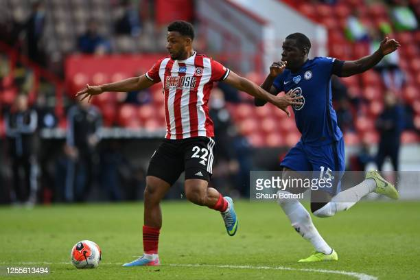 Lys Mousset of Sheffield United and Kurt Zouma of Chelsea battle for the ball during the Premier League match between Sheffield United and Chelsea FC...