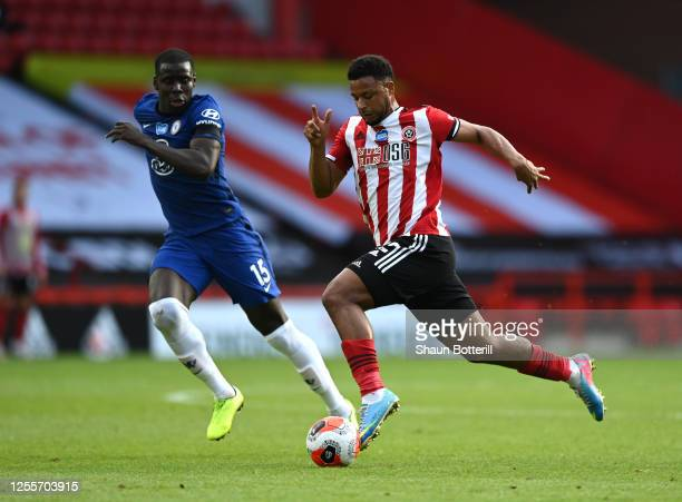Lys Mousset of Sheffield United breaks with the ball as Kurt Zouma of Chelsea looks on during the Premier League match between Sheffield United and...