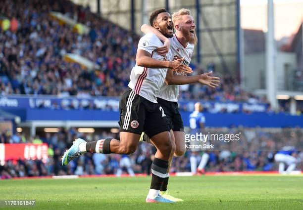 Lys Mousset of Sheffield United celebrates after scoring his team's second goal with Oliver McBurnie during the Premier League match between Everton...