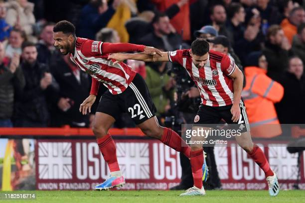 Lys Mousset of Sheffield United celebrates with George Baldock of Sheffield United after he scores his sides first goal during the Premier League...