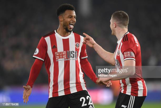 Lys Mousset of Sheffield United celebrates with teammate John Lundstram after scoring his sides second goal during the Premier League match between...