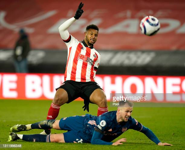 Lys Mousset of Sheffield United has a shot blocked by Rob Holding of Arsenal during the Premier League match between Sheffield United and Arsenal at...